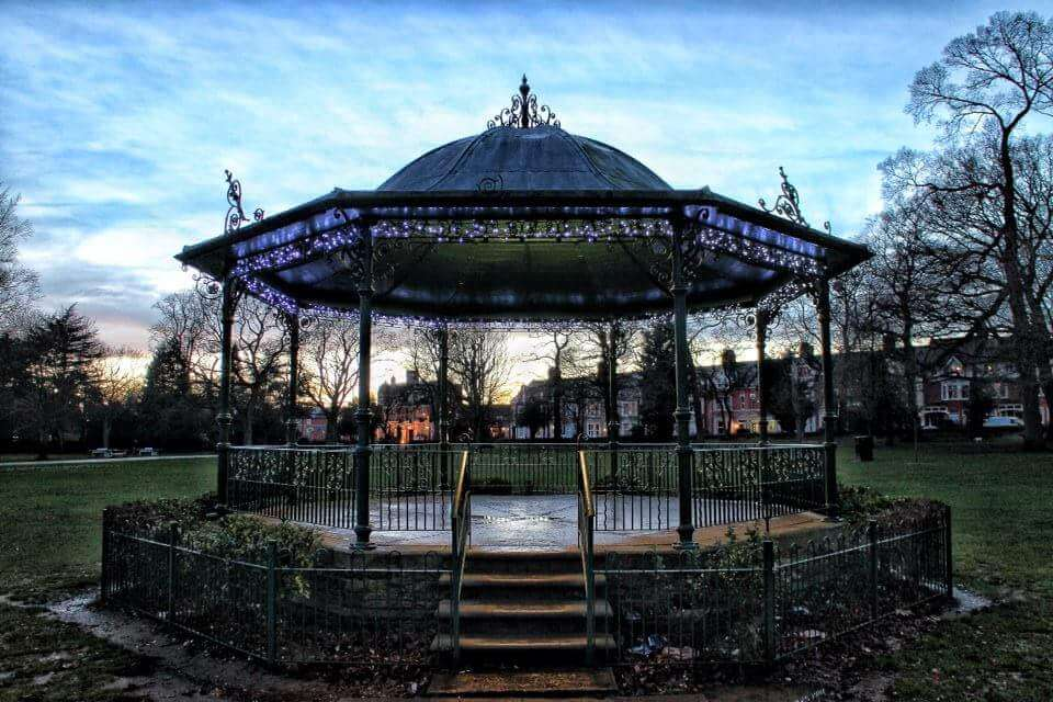 An old fashioned bandstand in the middle of a park