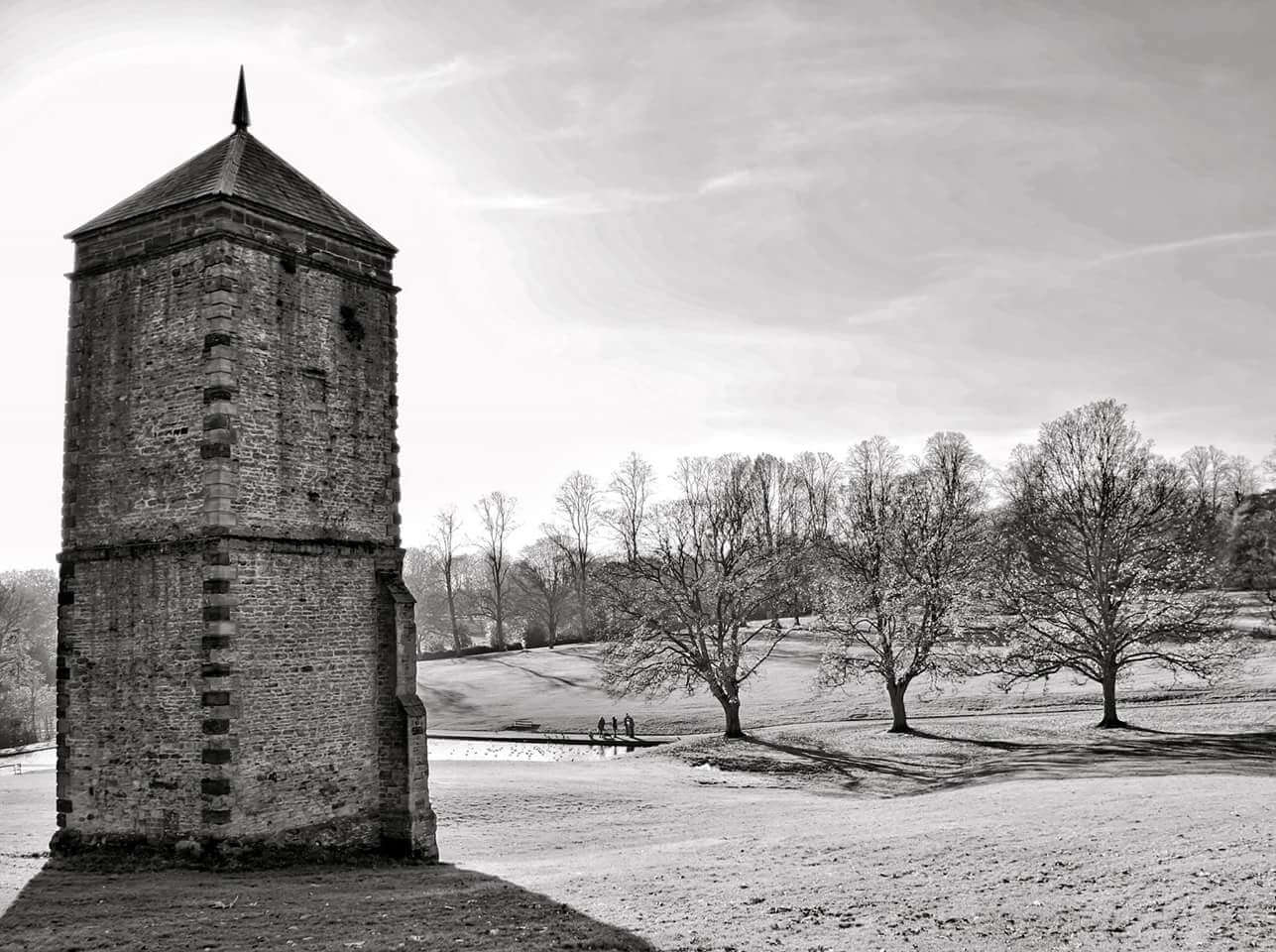 An 18th century brick tower standing in the middle of parkland