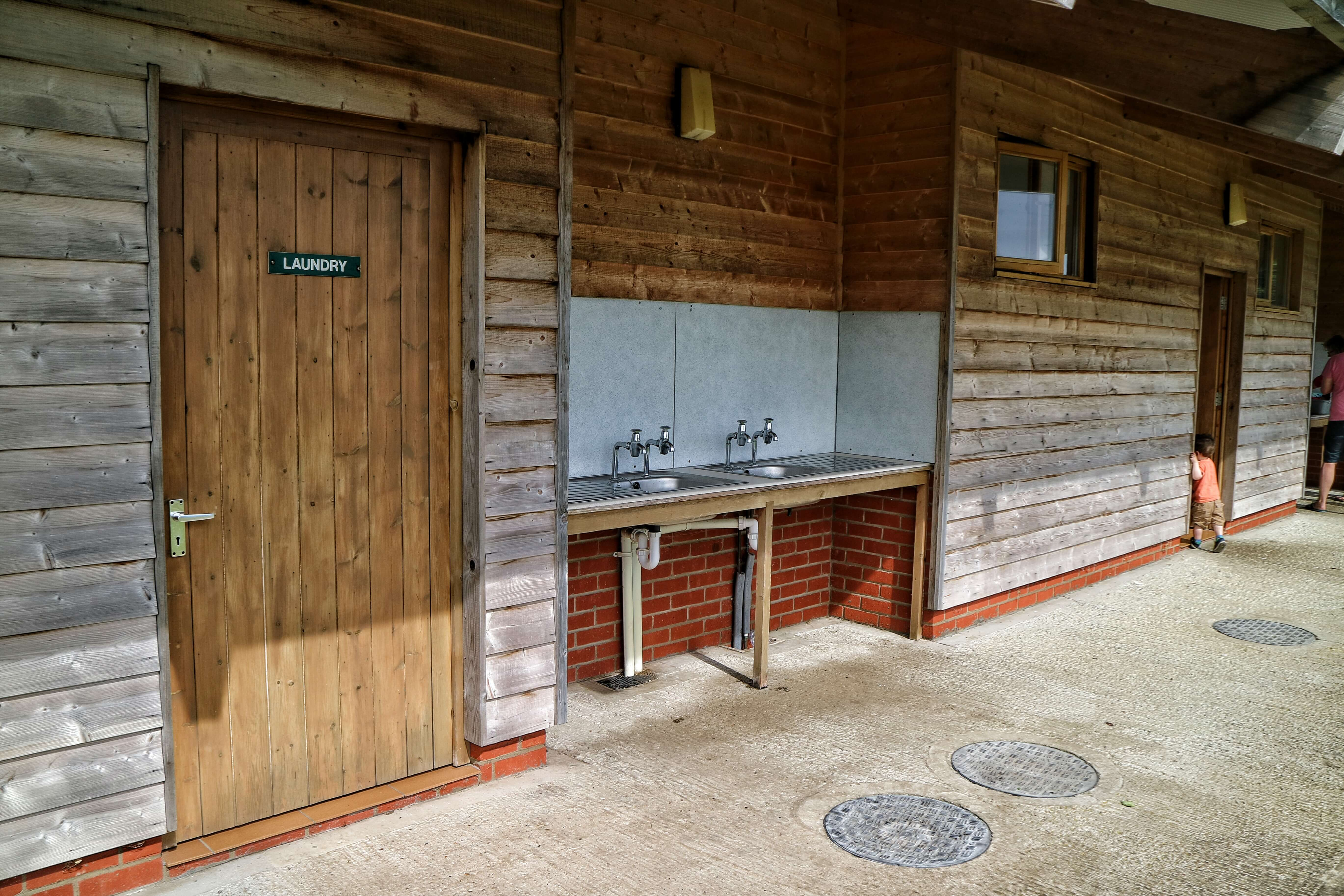 The toilet and shower block on a campsite. There also is a laundry room and washing up sinks.